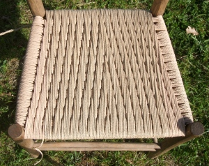 The seat woven by JoJo based on a pattern of Beth's in September 2012, which in turn was based on a stool woven by Emma about 4 years ago