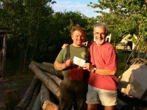 Handing over a cheque for the logs