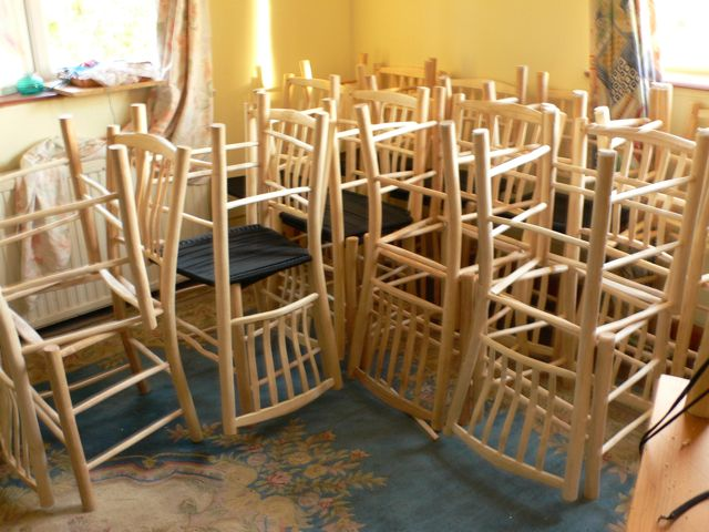 Two dozen lath-back chairs