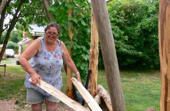 Jackie with her cleft ash, containing a pair of chair legs